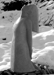 Portland stone kneeling figure in snow